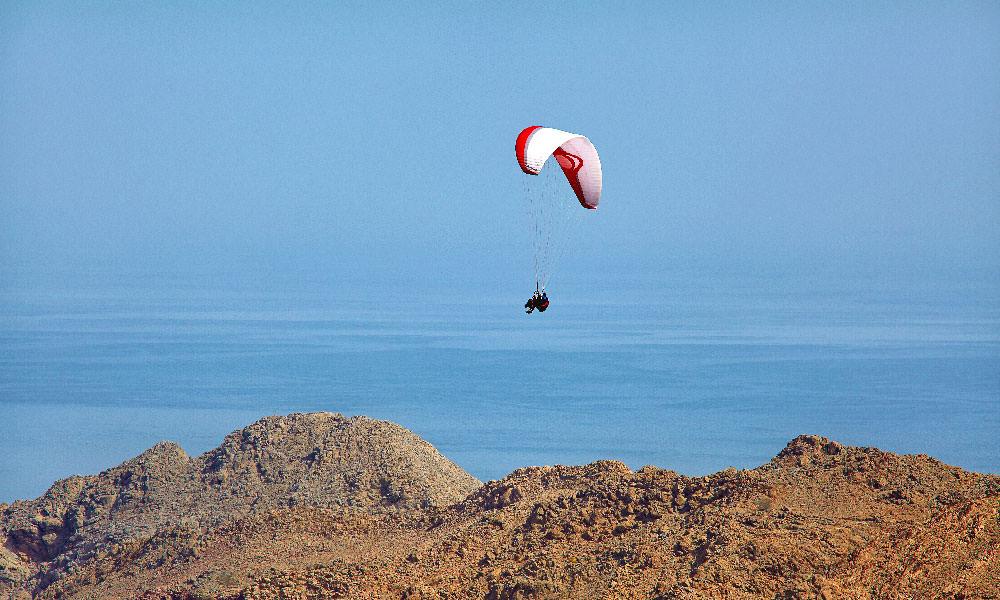 Paragliding at Six Senses Zighy Bay